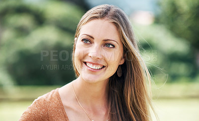 Buy stock photo Shot of an attractive young woman in the park