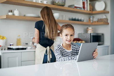 Buy stock photo Shot of an adorable little girl baking with her mother in the kitchen at home