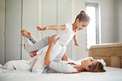 Buy stock photo Shot of an adorable little girl spending time with her beautiful mother at home
