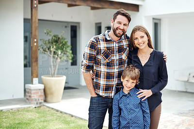 Buy stock photo Portrait of a happy family standing outside their home