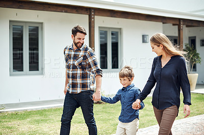 Buy stock photo Shot of a happy family walking together outdoors