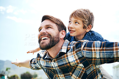 Buy stock photo Shot of a father and his little son bonding together outdoors