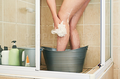 Buy stock photo Cropped shot of an unrecognizable woman washing in a bucket that has been placed in the shower at home