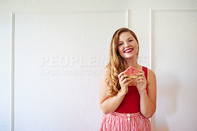 Buy stock photo Cropped shot of a beautiful young woman posing with a watermelon against a white wall indoors