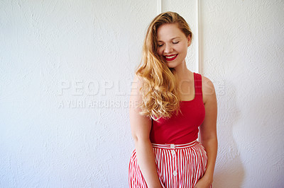 Buy stock photo Cropped shot of a beautiful young woman posing against a white wall indoors