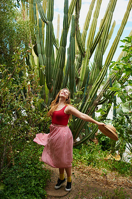 Buy stock photo Shot of a beautiful young woman in the backyard at home