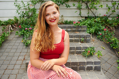 Buy stock photo Cropped shot of a beautiful young woman sitting on steps outside