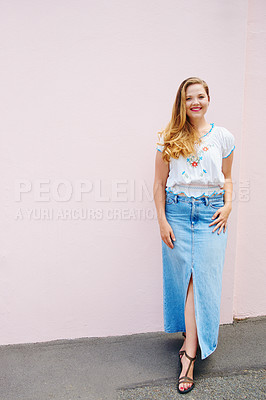 Buy stock photo Shot of a beautiful young woman posing against a pink wall outside
