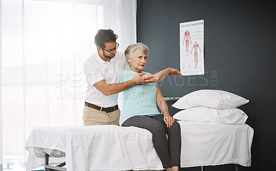 Buy stock photo Cropped shot of a young male physiotherapist working with a senior female patient