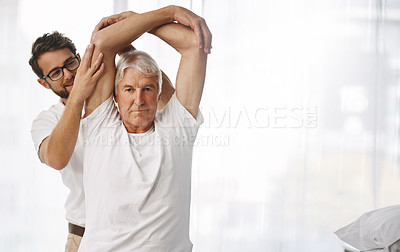Buy stock photo Cropped shot of a young male physiotherapist working with a senior male patient