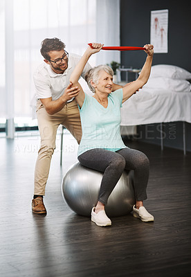 Buy stock photo Full length shot of a young male physiotherapist working with a senior female patient