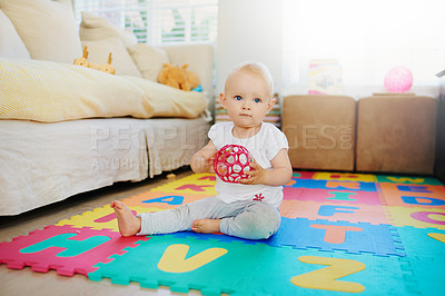 Buy stock photo Shot of an adorable baby girl playing with a toy at home