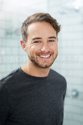 Buy stock photo Portrait of a happy young man standing in his bathroom