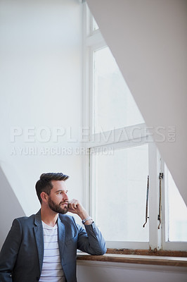 Buy stock photo Cropped shot of a handsome young businessman standing by his bedroom window