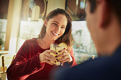 Buy stock photo Shot of a young man and woman on a romantic date at a coffee shop
