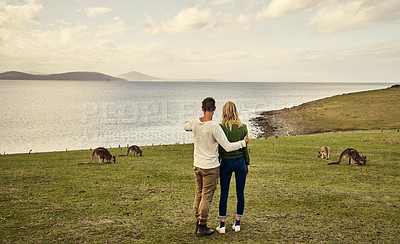Buy stock photo Rearview shot of an unrecognizable couple spending the day in nature