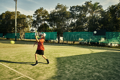 Buy stock photo Full length shot of a young boy playing tennis