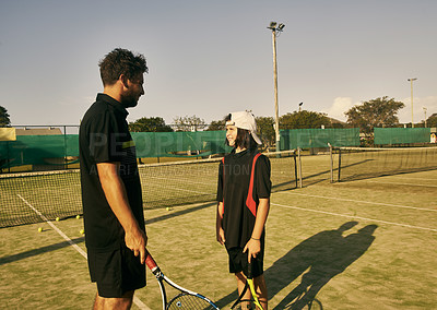 Buy stock photo Cropped shot of a young boy talking to his coach during tennis practice