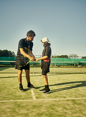 Buy stock photo Full length shot of a young boy working on his tennis game with his personal trainer