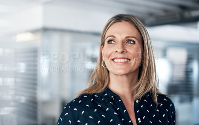 Buy stock photo Shot of a confident mature businesswoman working in a modern office