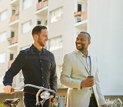 Buy stock photo Cropped shot of two businessmen on their way to work