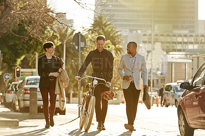 Buy stock photo Full length shot of three businesspeople on their way to work
