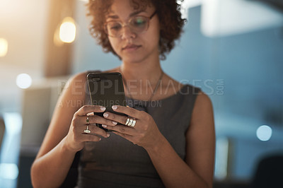 Buy stock photo Cropped shot of a young businesswoman working in a modern office at night