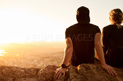 Buy stock photo Rearview shot of an unrecognizable young couple taking in the views during their hike in the mountains