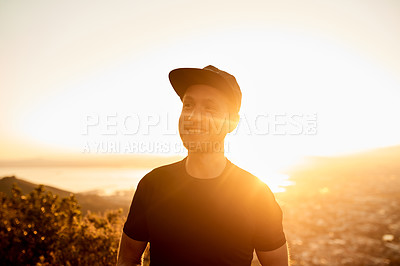 Buy stock photo Cropped shot of a young man enjoying an early morning hike in the mountains
