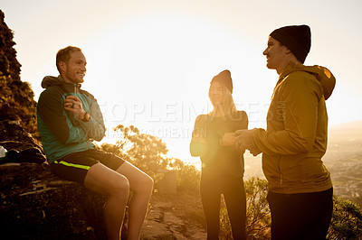 Buy stock photo Full length shot of three young friends taking a break from their mountain hike