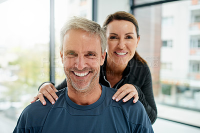 Buy stock photo Portrait of a cheerful middle aged man standing together with his personal trainer about to workout inside of a gym during the day