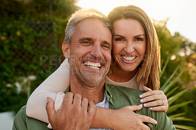 Buy stock photo Cropped portrait of an affectionate mature couple standing outside