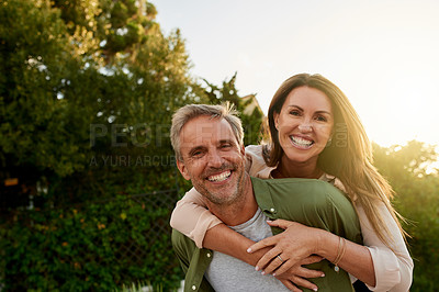 Buy stock photo Cropped portrait of a handsome mature man piggybacking his beautiful wife outside