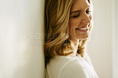 Buy stock photo Shot of an attractive young woman spending a relaxing day at home