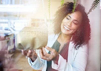 Buy stock photo Shot of a beautiful young woman on a shopping spree