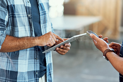 Buy stock photo Closeup shot of two unrecognizable designers using digital devices in an office
