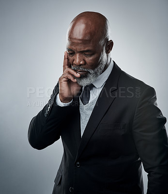 Buy stock photo Studio shot of a mature businessman looking thoughtful against a grey background