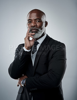 Buy stock photo Studio portrait of a mature businessman against a grey background