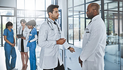 Buy stock photo Shot of two doctors having a discussion in a hospital