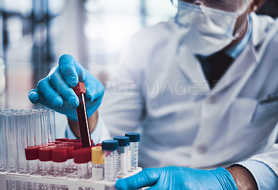 Buy stock photo Cropped shot of an unrecognizable male scientist working in a lab