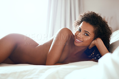 Buy stock photo Cropped portrait of a gorgeous young woman posing seductively in her bedroom