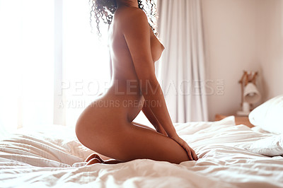 Buy stock photo Cropped shot of a unrecognizable young woman posing seductively in her bedroom