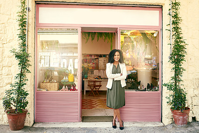 Buy stock photo Shot of a shoe shop owner standing in front of her shop