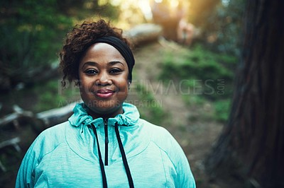 Buy stock photo Portrait of a sporty young woman ready to workout in the forest