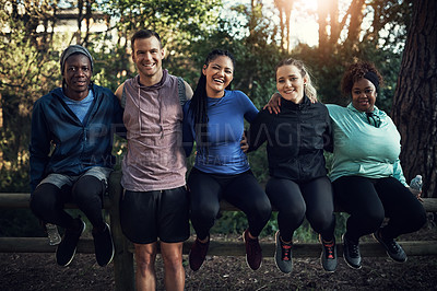Buy stock photo Portrait of a group of sporty young friends working out in the forest