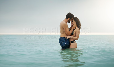 Buy stock photo Shot of an affectionate couple spending some time in the water