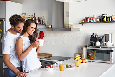 Buy stock photo Shot of a young couple having a relaxing breakfast together at home