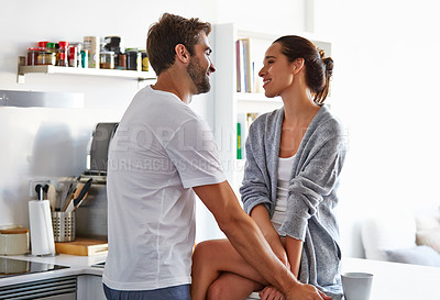 Buy stock photo Shot of an affectionate young couple spending time together in the morning at home