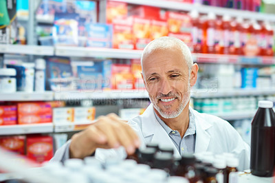 Buy stock photo Shot of a mature pharmacist working in a chemist