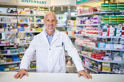 Buy stock photo Portrait of a mature pharmacist working in a chemist